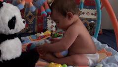 Baby plays with photocamera 2 Stock Footage
