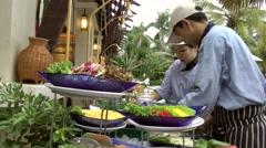 Thailand Pattaya 033 ravindra beach resort, waiters prepare the buffet Stock Footage