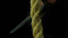 Cutting the rope with scissors. Stock Footage
