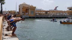Bay ocean swimmers swimming race start 1 Stock Footage