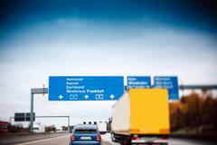 busy highway autobahn road traffic in germany - stock photo