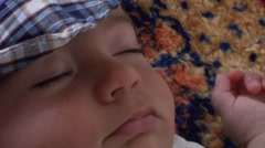 Sweet baby in cap asleep zoom out Stock Footage
