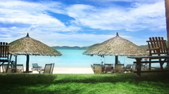 Sun umbrellas and chairs on beach. Stock Footage
