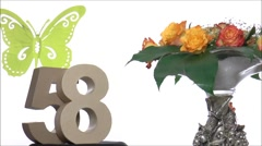 Moving birthday card with a butterfly for reaching 58 - stock footage