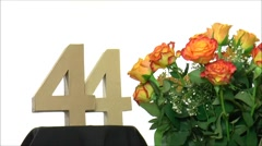 Moving birthday card with lovely roses for reaching 44 - stock footage