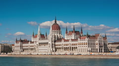 View of the parliament building in Budapest in the sunny summer day, timelapse Stock Footage