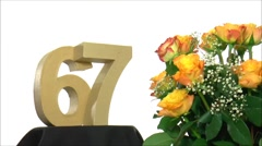 Moving birthday card with lovely roses for reaching 67 - stock footage
