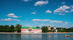 Kuskovo palace and pond with boats in the sunny summer day, timelapse Stock Footage