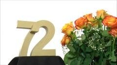 Moving birthday card with lovely roses for reaching 72 - stock footage