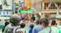 Time lapse of people and traffic crossing with statue foreground, Shibuya Footage