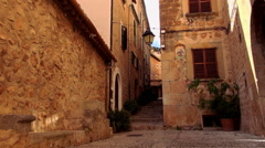 Narrow lane in romantic small spanish village Stock Footage