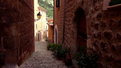 Narrow empty lane in romantic small spanish village Stock Footage