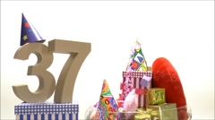 Moving birthday card with party mood for reaching 37 - stock footage