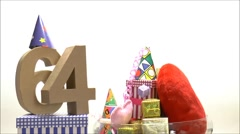 Moving birthday card with party mood for reaching 64 Stock Footage