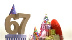 Moving birthday card with party mood for reaching 67 Stock Footage