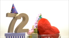 Moving birthday card with party mood for reaching 72 Stock Footage