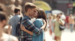 4K & HD resolutions, SLOW MOTION: Lovers stand above the crowd at the street Stock Footage