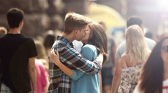 4K & HD resolutions: Lovers stand in the crowd stream at the street, summer Stock Footage