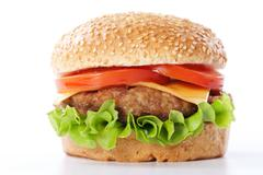 Cheeseburger with tomatoes and lettuce Stock Photos