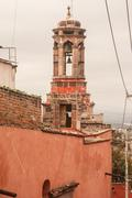mexican rooftop with belltower - stock photo