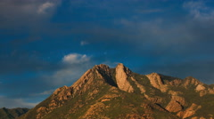 Sunset Clouds over Mountain Peak (4K) Stock Footage