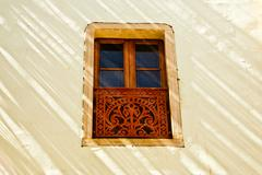Decorative window in sunlight and shadow Stock Photos