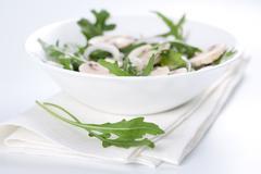Salad with rucola and mushrooms Stock Photos