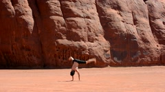 Boy dancing breakdance in the famous Monument Valley USA Stock Footage