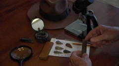 Archaeologist, arrowheads, studying the past Stock Footage