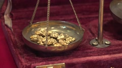 GOLD NUGGETS IN SCALE Stock Footage