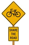 share the road with bicycles sign - stock photo