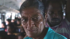 Interior view of an elderly woman and crowded in a bus from Galle to Hikkaduwa. Stock Footage