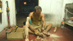 Local sculptor working in his shop in Hikkaduwa. Stock Footage