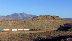 Distant Freight Train Rolling Through Desert Valley- Kingman AZ Stock Footage