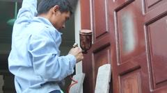 painter paint wooden door - stock footage