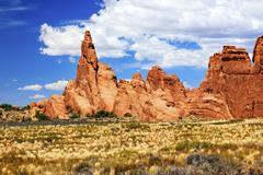 Rock pinnacle formation canyon grasslands arches national park moab utah Stock Photos