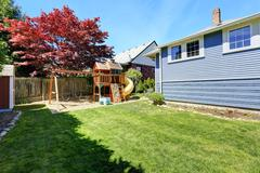 house backyard with playground for kids - stock photo