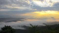 Morning mist flows over the mountain Doi Samer Dao Nan Thailand Stock Footage