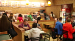 Fast food restaurant out of focus Stock Footage