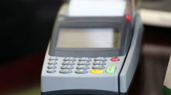 Close up image of a credit card being swiped through a card machine. Stock Footage