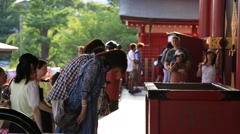 People praying at Senso-ji temple, Tokyo, Japan Stock Footage