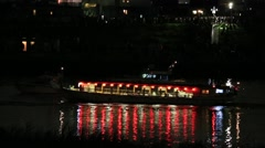 Boats cruising on Arakawa river at night, Tokyo, Japan Stock Footage