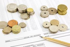 World coins stack on funding account summarizing for financial concept Stock Photos