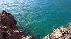 Turquois water at a rocky coast Stock Footage