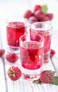 glass with raspberry liqueur - stock photo
