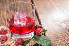 homemade raspberry liqueur - stock photo