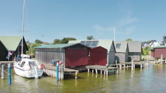 Cabins at the Harbour of Ahrendshoop, Fishland, Germany Stock Footage
