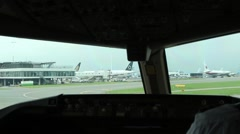 Airplane taxiing on airport. View from the cockpit Stock Footage
