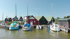 Sailing boats and cabins at the Harbour of Ahrendshoop, Fishland, Germany Stock Footage