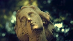 Female statue in cemetery - stock footage